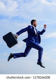 Businessman formal suit make effort to succeed. Supernatural power. Success in business demands supernatural efforts from entrepreneur personality. Businessman with briefcase jump high motion forward.