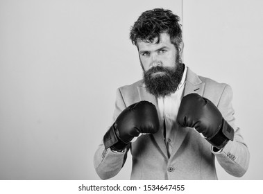 Businessman in formal suit ready to attack or defend. Fighting for business success. Businessman confident in his skills. Strong and powerful. Business as fight on economics arena. Business strategy.