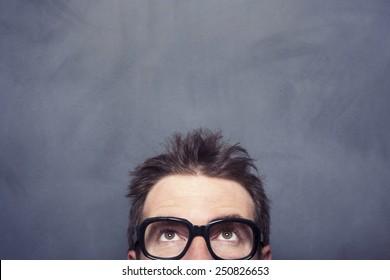Businessman front of the blank blackboard
