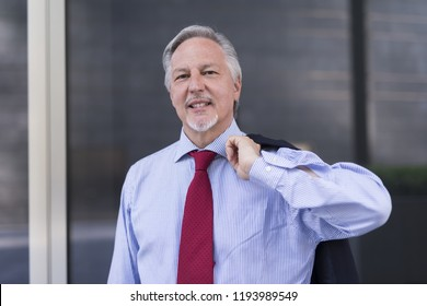 Businessman in front of his office