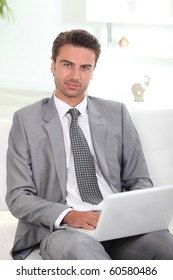 Businessman in front of laptop computer