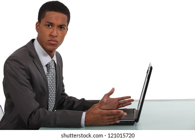 Businessman frustrated by laptop