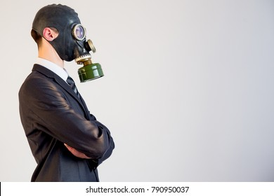 Businessman in a gas mask