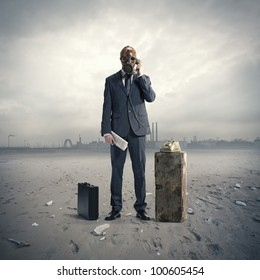 businessman with gas mask at phone