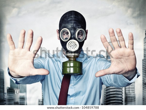 businessman with gas mask stop posture