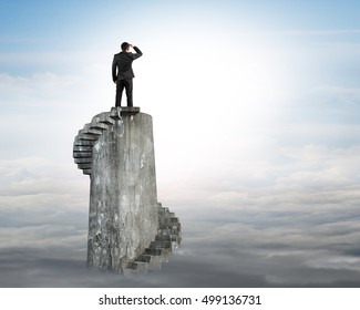 Businessman gazing on top of concrete spiral tower, with sky sun clouds background.