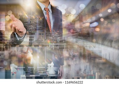Businessman with gesture The double exposure image of the business man standing back during sunrise overlay with cityscape image. The concept of modern life, business, city life and internet of thing