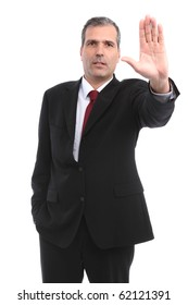 businessman gesturing STOP with his hand in a white background