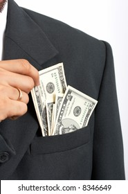 A businessman getting dollar notes from his suit pocket