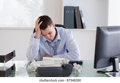 Businessman getting frustrated by paperwork