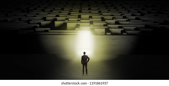 Businessman getting ready to enter the dark labyrinth with illuminated door