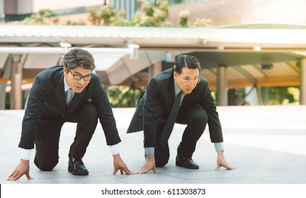 businessman getting ready for race competition business rival concept .