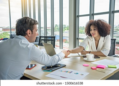 BusinessMan give hand as hello in office Female legal advisor.Friend welcome mediation offer positive introduction thanks deal partner at meeting room.