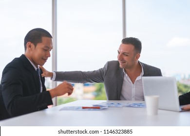 Businessman was given appreciate and compliments from his boss who successfully worked.