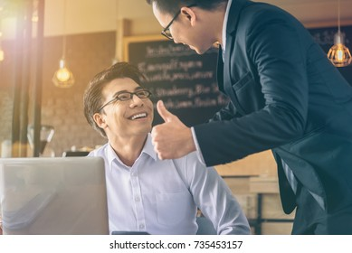 Businessman was given a thumbs-up and compliments from his boss who successfully worked.