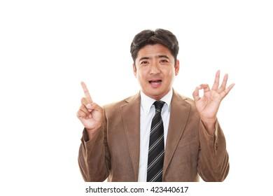 Businessman gives OK sign