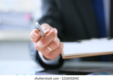 Businessman gives pen offers to sign new job employment contract.