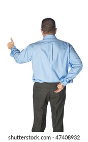 A businessman gives a thumbs up and has his fingers crossed behind his back as if lying or deceiving his clients.