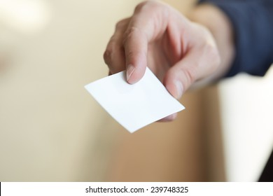 businessman giving a business card