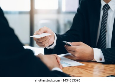 Businessman giving a business card. Business partners and colleague.