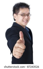 Businessman giving an enthusiastic thumb up