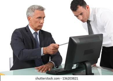 businessman giving explanations to his boss