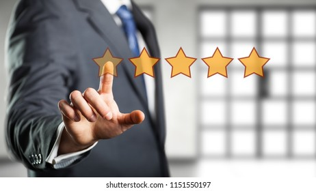 businessman giving a five star rating