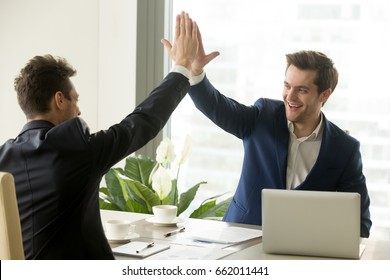 Businessman giving high five to his partner on meeting, positive management team celebrating victory, successful stock deal, sales growth, won good contract, business achievement and teamwork concept