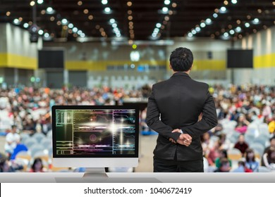 Businessman giving the knowledge with showing Cryptocurrency trading screen, Bitcoin exchange screen of trading information over blurred photo of attendee in Exhibition Center,Business Seminar concept
