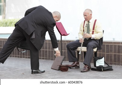 Businessman giving money to the clarinet player
