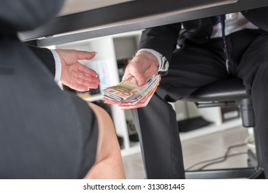 Businessman giving money under a table
