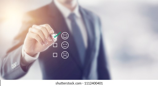 Businessman giving rating with happy icon, Customer satisfaction survey concept, copy space