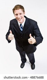 Businessman giving thumbs up gesture