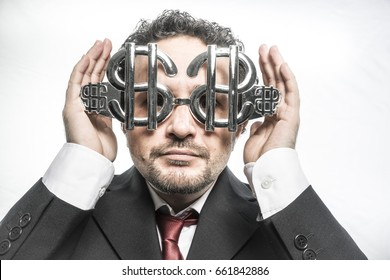 Businessman with glasses in the form of silver dollar, expressions of surprise nerves, stress and power
