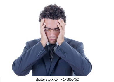 businessman with glasses holding his head in pain