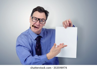 Businessman in glasses holding a paper. You signed contract concept.