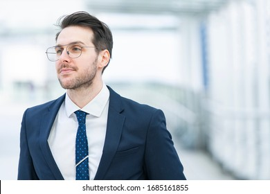Businessman with glasses showing a smile