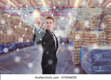 Businessman with global network coverage world map on hand of businessman ,Distribution of goods in warehouse process for Logistic Import Export background (Elements of this image furnished by NASA)