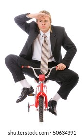 Businessman goes on children's bicycle, isolated on white background.