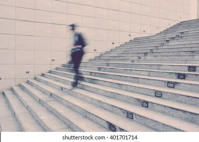 Businessman going down the stairs, blurred motion