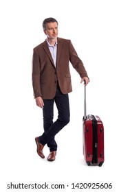 Businessman going on a business trip and traveling with luggage.  The man is carrying bags like preparing to board a flight at an airport.