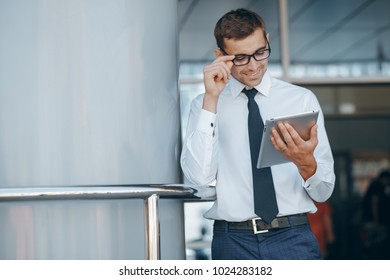 businessman going over meeting plans on a tablet outside the office