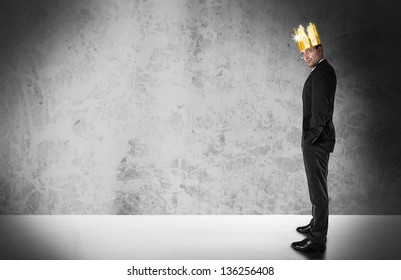 Businessman with golden crown