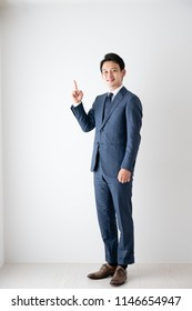 Businessman, good, thumbs up, touches a finger