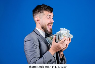 Businessman got cash money. Gain real money. Richness and wellbeing concept. Cash transaction business. Easy cash loan. Man formal suit hold many dollar banknotes blue background. Take my money.