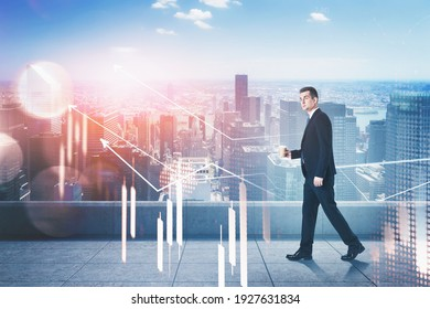 Businessman with graphs, double exposure, walking on the roof of business building, horizon of cityscape. Young man in black suit with coffee. Concept of working in corporation