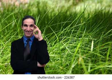 businessman with grass in the background