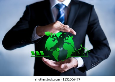 Businessman with a green globe. eco-friendly business. Business and environmental concepts