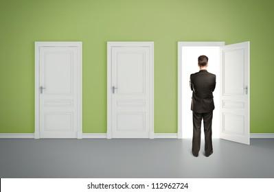businessman in green room with three door