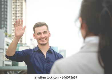 Businessman greet and say hello freind colleague in city outdoor